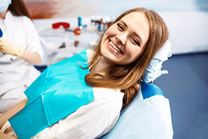 Woman sitting on dentist chair smiling