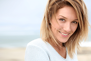 woman on beach smiling