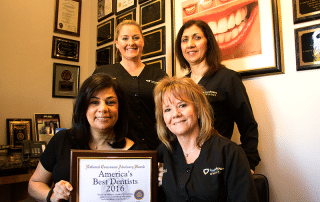 """""""Best Dentists"""" in Los Gatos, Dr. Nehawandian with her award and team"""
