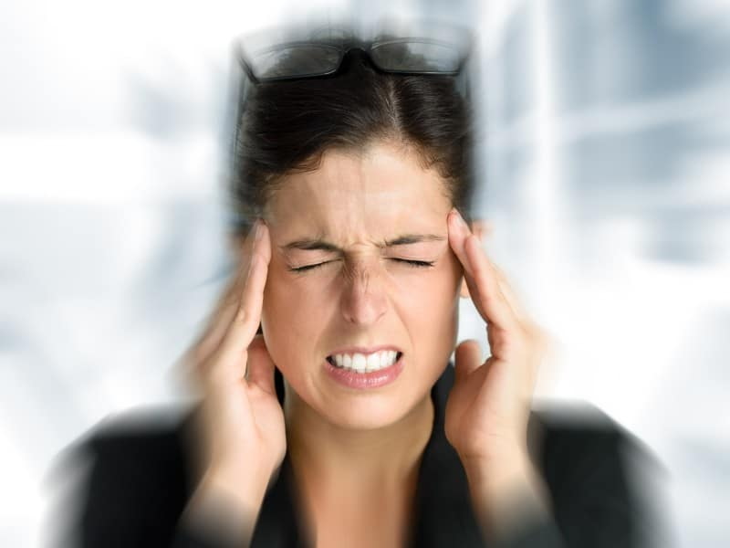 woman suffering from painful migraine