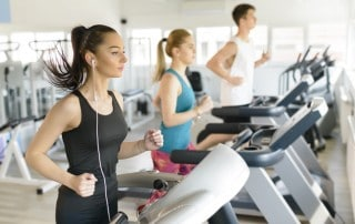 3 young people exercising at the gym