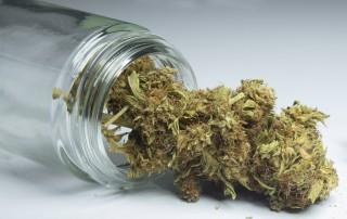A jar spilling out marijuana