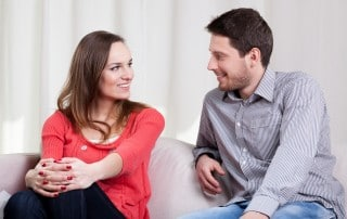 A couple discusses their relationship on the couch