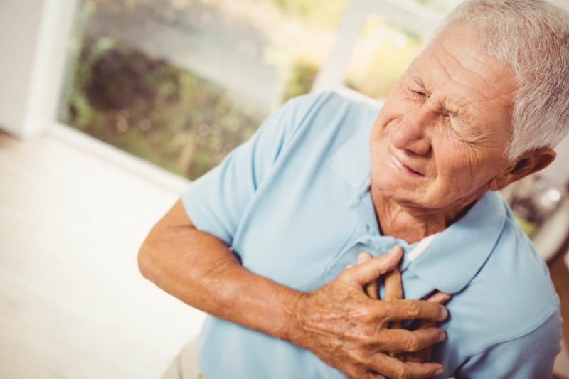 older man suffering from chest pains