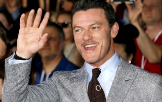 Actor Luke Evans shows off his unique canine teeth at a Hollywood event