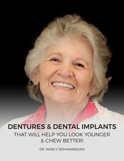 Older woman showing off her implant dentures