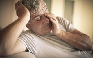 Aged man rubbing eyes and head. Is your Sleep Apnea aging you?