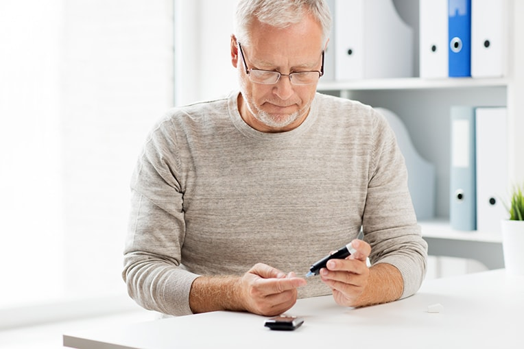Senior man with glucometer checking blood sugar. If you believe your diabetes is affecting your oral health, or if you're interested in learning more about how holistic dentistry can lead to a healthier you, please schedule an appointment with Top Down Dental in Los Gatos, California.
