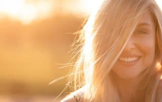 woman's face being illuminated by the warm sunshine